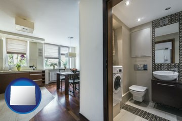 a modern bathroom and kitchen - with Wyoming icon